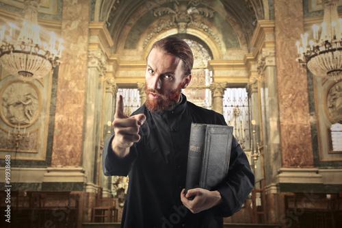 Priest warning a sinner Fototapeta