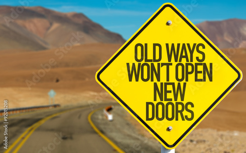 Fotografia, Obraz Old Ways Wont Open New Doors sign on desert road