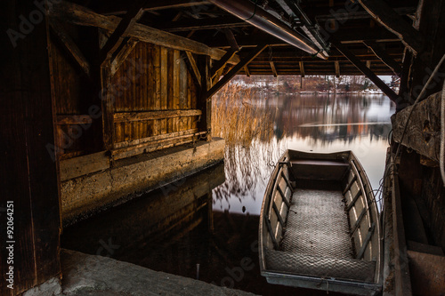 Photo Forgotten boat house on a silent lake