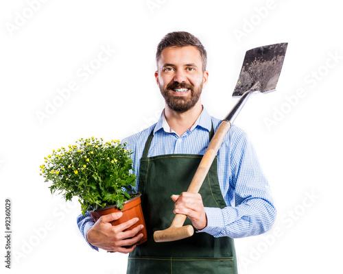 Young handsome gardener Fototapeta