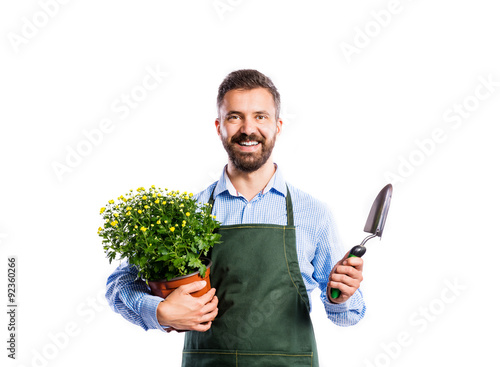 Valokuva Young handsome gardener