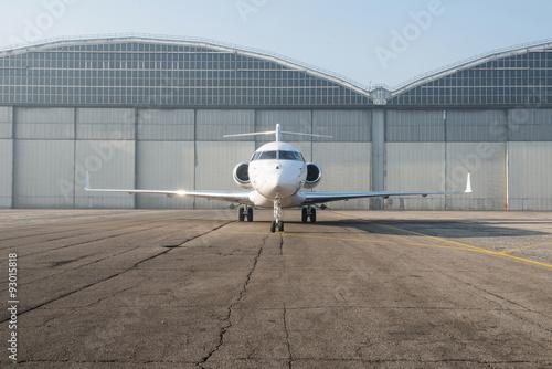 Business jet plane on the ground. Fototapet