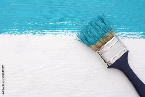 Obraz na plátně Pruh tyrkysovou barvou s štětec na bílém