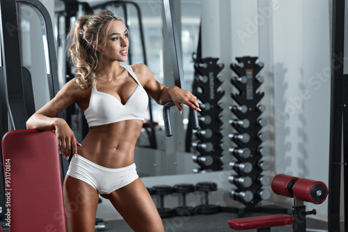 Young sexy woman in the gym