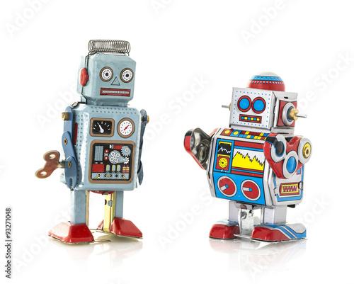 Two Retro Tin Robot on a White Background