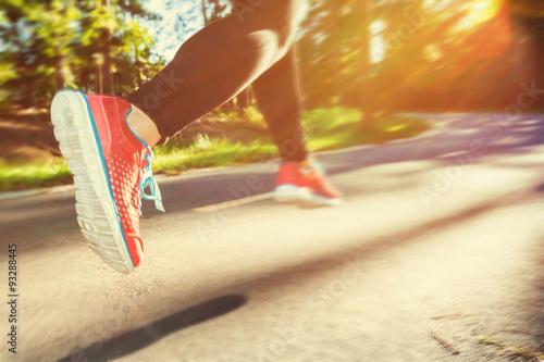 Wallpaper Mural Woman runner jogging down an outdoor trail