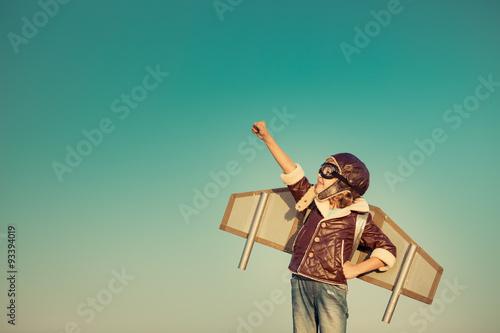 Obraz na plátne Happy child playing with toy airplane