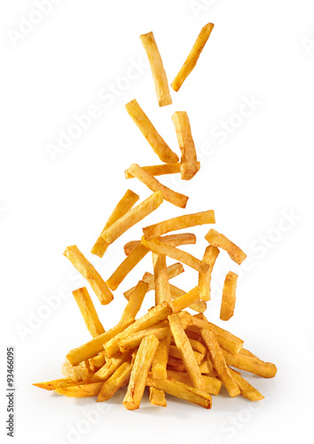 Photo Flying fried potatoes isolated on white background. French fries