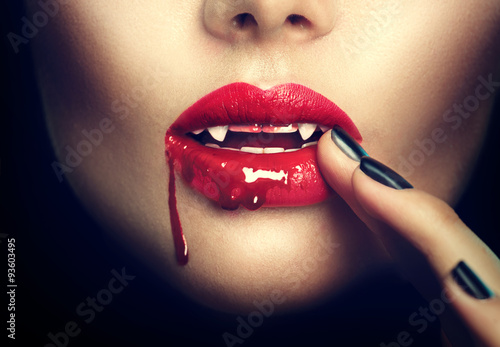 Photo Halloween. Sexy vampire woman lips with blood