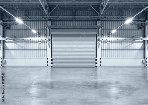 Valokuvatapetti Roller door or roller shutter inside factory, warehouse or industrial building