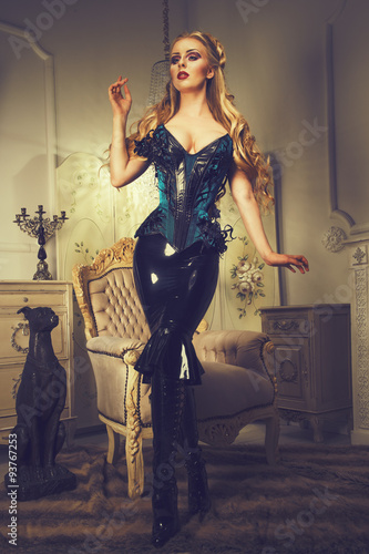 Leinwand Poster elegant woman in blue corsetry