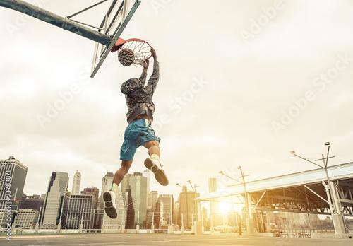 Wallpaper Mural Basketball street player making a rear slam dunk