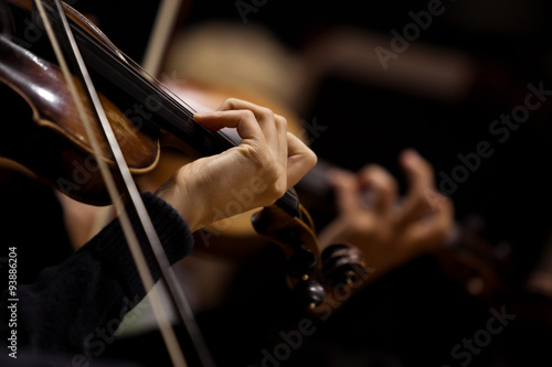 Carta da parati The hands of violinists in a Symphony orchestra