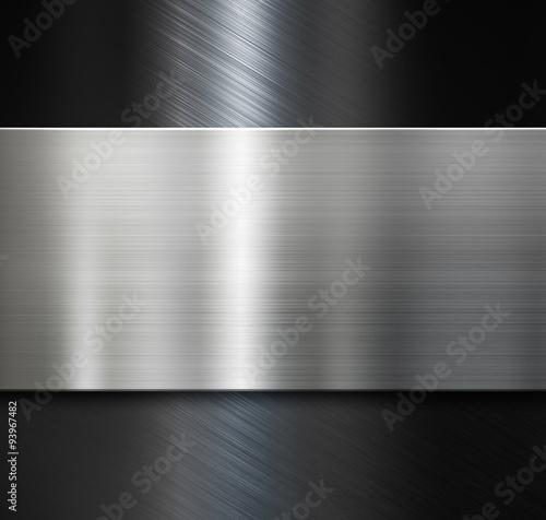 metal plate over black brushed metallic background