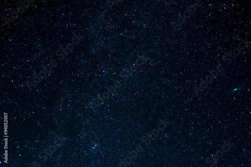 starry night dark sky with tracks from shooting stars