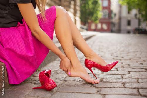 Fototapeta Woman with injured foot