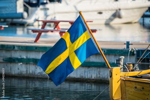 Wallpaper Mural Sweden flag on a boat