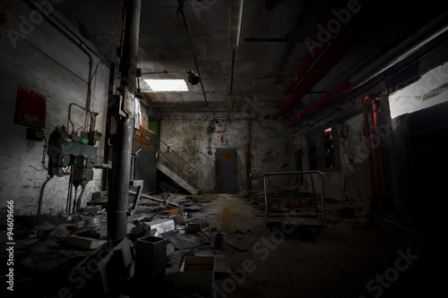 garbage, dirty room in an abandoned old factory workshop