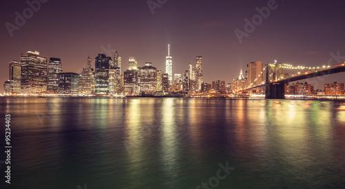 Vintage toned Manhattan waterfront at night, NYC, USA.