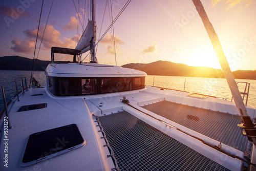 Beautiful view to catamaran in Seychelles bay at sunset Fotobehang