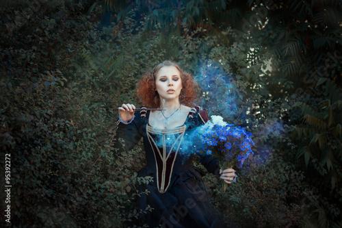 Fototapeta Girl with a magic wand.