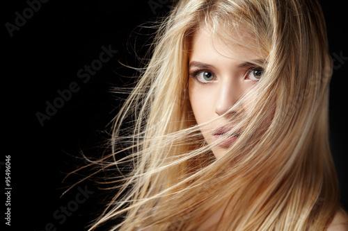 Portrait of beautiful  blonde woman with flying hair. Fototapeta