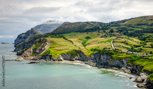 Cantabria landscape with hill, field and abrupt coast of the Atlantic Ocean. Spain.