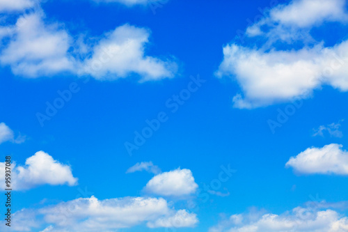 blue sky with white fluffy clouds background
