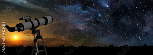 Fotografija milky way at sunset and telescope in the foreground