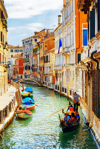 Canvas Print Tourists traveling in gondola, Rio Marin Canal, Venice, Italy