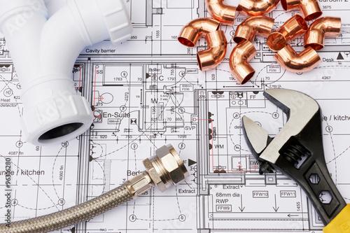 Fotografija Plumbing Components Arranged On House Plans