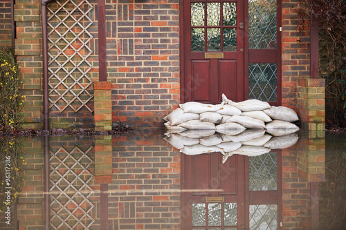 Fotografia, Obraz Sandbags Outside Front Door Of Flooded House