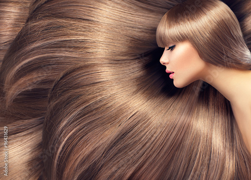 Billede på lærred Beautiful hair. Beauty woman with shiny long hair as background