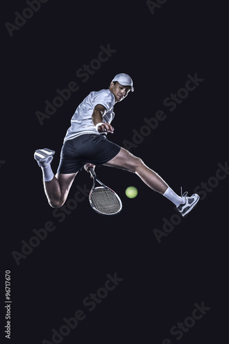 Canvas Print Tennis player reaching for the hard ball isolated