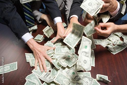 Fototapeta Businesspeople grabbing money