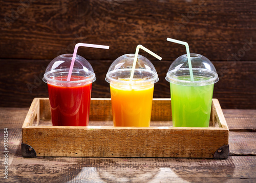 glasses of fresh juices in a tray #97551254