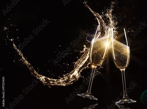Glasses of champagne with splash Fototapeta