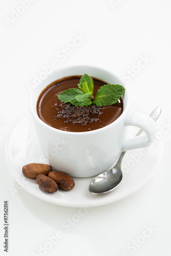 cup with hot mint chocolate on white table, vertical #97562814