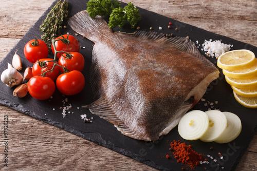 Fotografie, Tablou Fresh raw plaice with ingredients on a slate board. horizontal