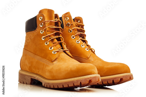 Fotografiet yellow winter boots isolated on white