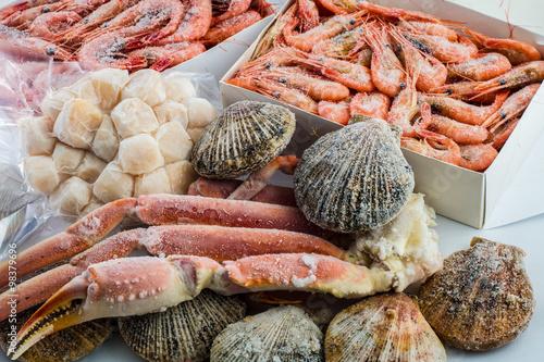 frozen shells of scallops, shrimps , crabs in a package