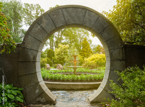 Canvas Print Stone archway in the garden