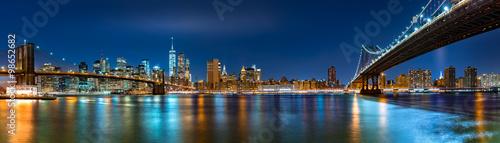 "Night panorama with the downtown New York City skyline and the ""Two Bridges"": Brooklyn Bridge and Manhattan Bridge, viewed from Brooklyn Bridge Park"