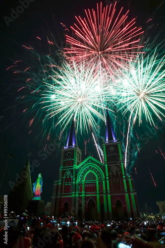 Colorful church and virgin mary with firework in the Christmas n #99306018