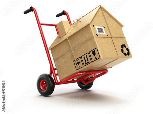 Fototapeta Delivery or moving houseconcept. Hand truck with cardboard box a