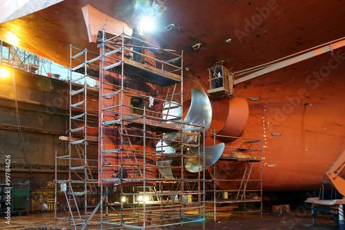 Fotografie, Tablou Renovation work at the helm of the ship shipyard during the renovation of the sh
