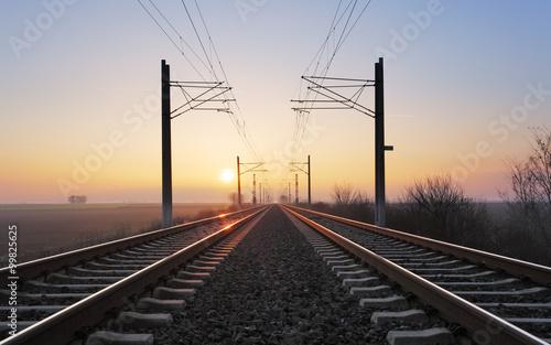 Obraz na plátně Rrailroad at a sunset
