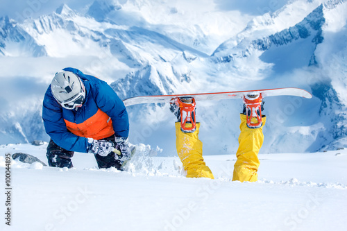 Canvas Print Backcountry snowboarder digging out his friend