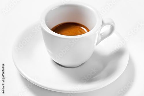 Obraz na płótnie A cup of coffee on a plate isolated on white background