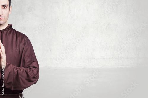 Canvas Print young friar praying